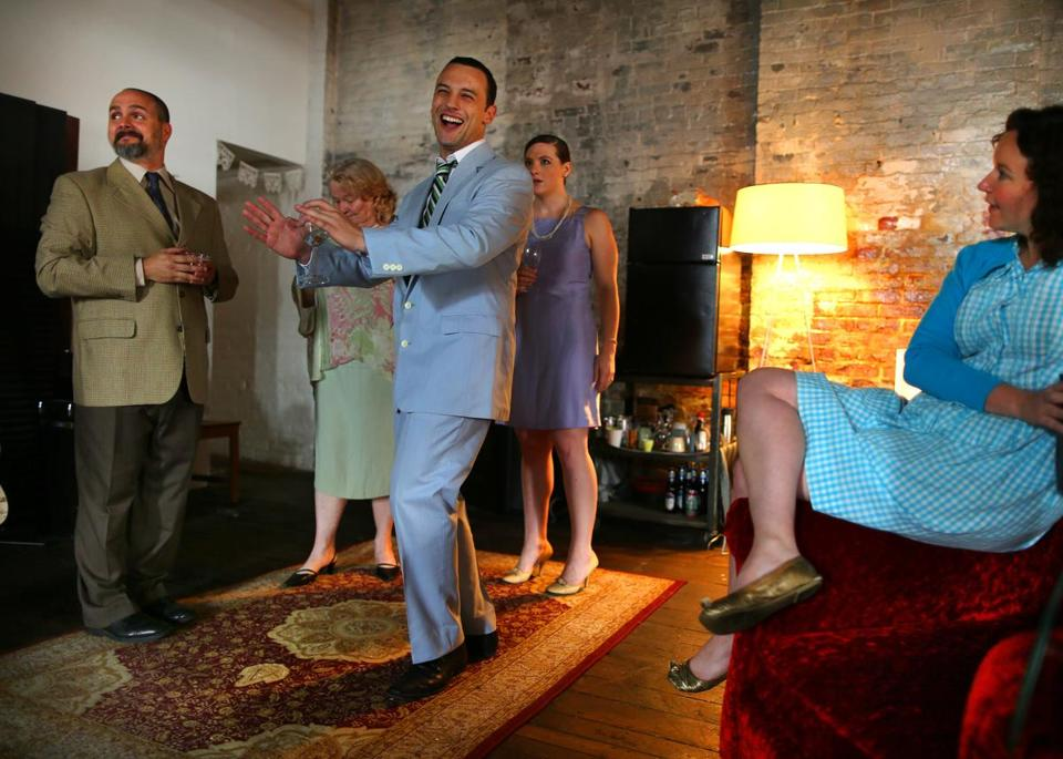 "Adam Siladi (center) and other members of the Theatre on Fire troupe rehearse ""Party Time,"" which will be performed mostly in private homes."