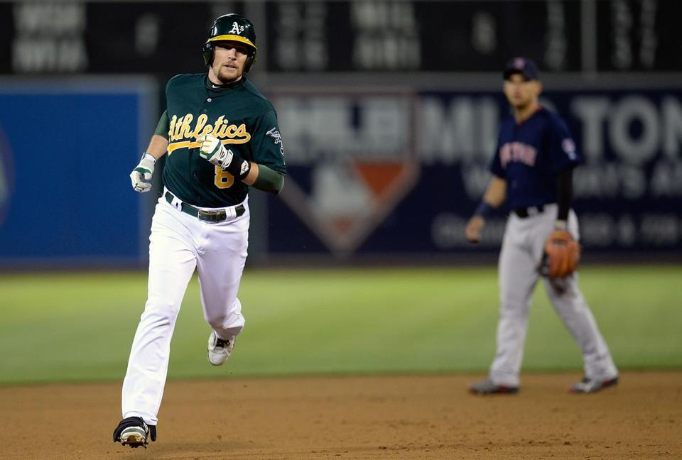 Former Red Sox infielder Jed Lowrie hit a home run against his former team on Friday as the Athletics lost to the Red Sox, 4-2.