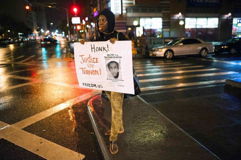 A protester held a sign during a rally in the Harlem neighborhood of New York in response to the acquittal of George Zimmerman.