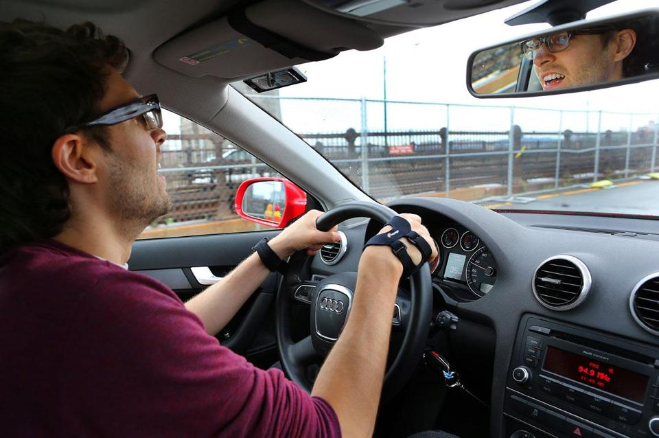 MIT grad student Kael Greco demonstrated stress monitoring devices on his wrist and hand as he drove in Boston and Cambridge traffic.