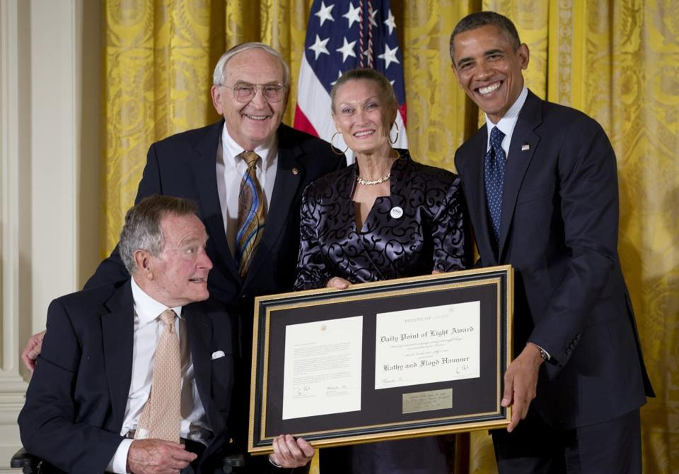 Former president George Bush and President Obama honored Floyd Hammer and Kathy Hamilton.