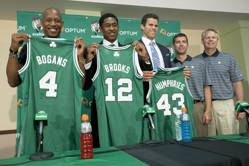 Keith Bogans, MarShon Brooks and Kris Humphries posed with their new Celtics jerseys. At right are head coach Brad Stevens and President of Basketball Operations Danny Ainge.