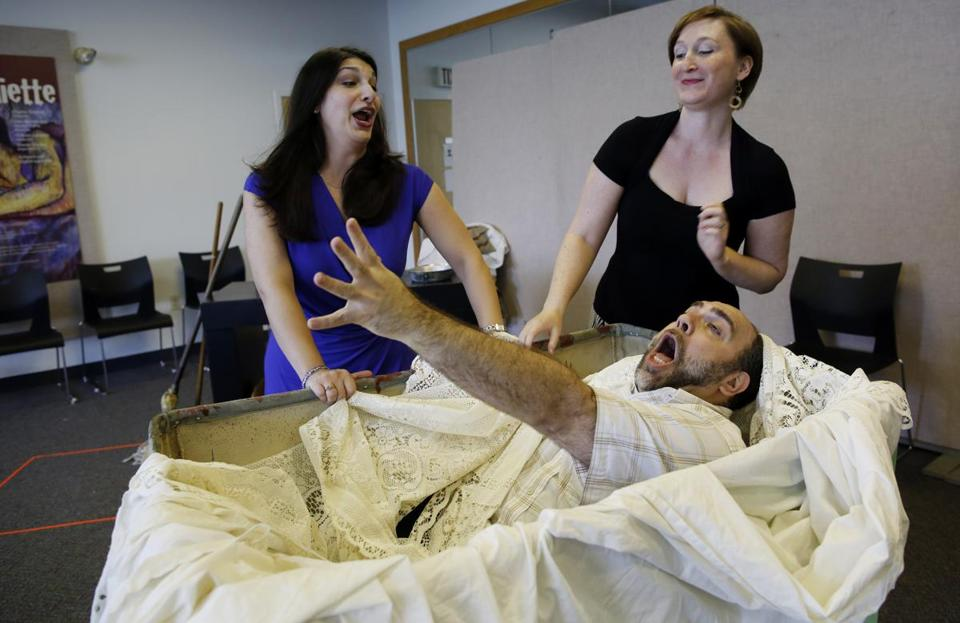 "Stephanie Kacoyanis (left), Martha Guth, and Jason Budd rehearse ""The Merry Wives"" for Boston Midsummer Opera."