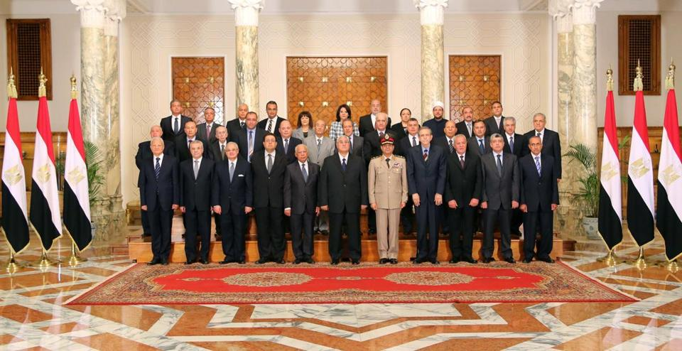 Interim Egyptian President Adly Mansour, center, with his new cabinet ministers at the presidential palace in Cairo, Egypt. Egypt's interim president has sworn in a new Cabinet, the first since the ouster of the Islamist president by the military nearly two weeks ago.