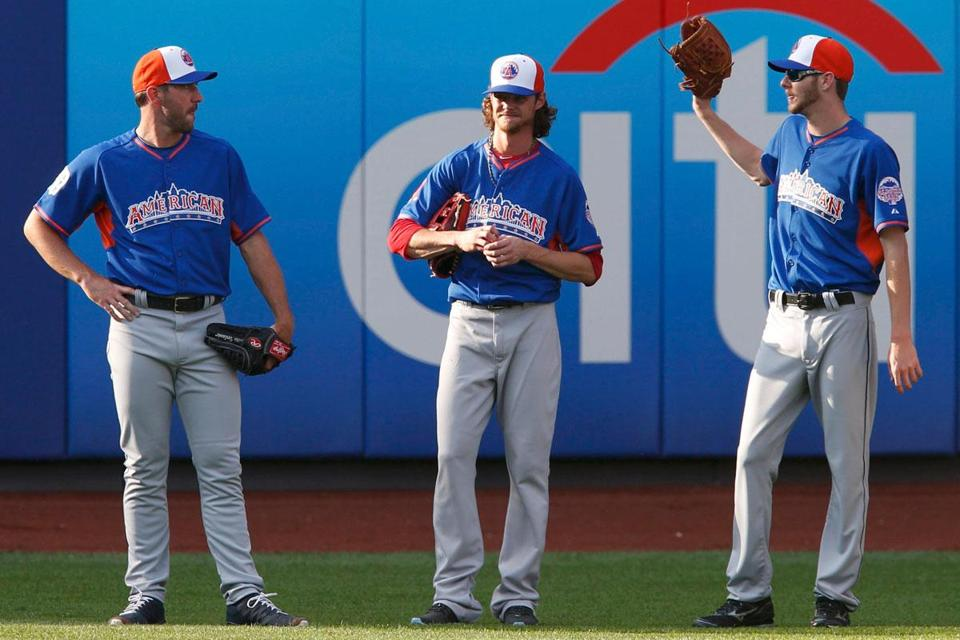 Injuries have caused Clay Buchholz (center) to miss pitching in both All-Star Games (2010, '13) he has been selected to.