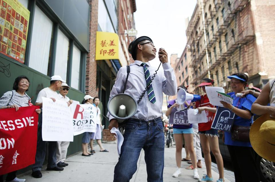 Changling Zhang, 18, of Malden, played the role of a developer during a rally for affordable housing in Chinatown.