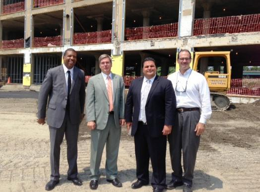 From left, state deputy housing secretary Arthur Jemison, housing secretary Greg Bialecki, Everett Mayor Carlo DeMaria Jr., and developer Andy Montelli at the candy site.