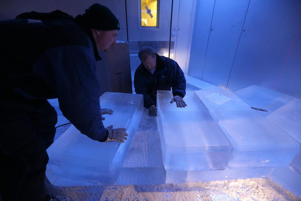 Workers from Iceculture, a Canadian ice-sculpting company, trimmed 300-pound blocks of ice for Frost Ice Bar in Faneuil Hall.