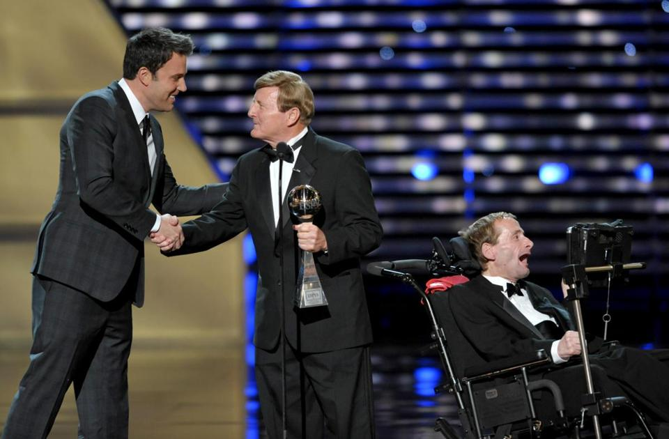 Dick Hoyt, center, and Rick Hoyt, right, accept the Jimmy V Perseverance Award from presenter Ben Affleck, left, at the ESPY Awards on Wednesday.