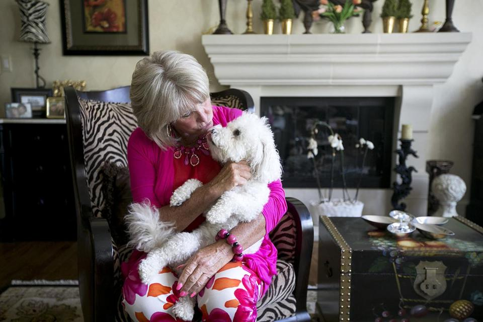 Susan Wornick with her dog Sammy at home in Needham. She announced in June that she will be retiring in March 2014 after more than 30 years in television news.