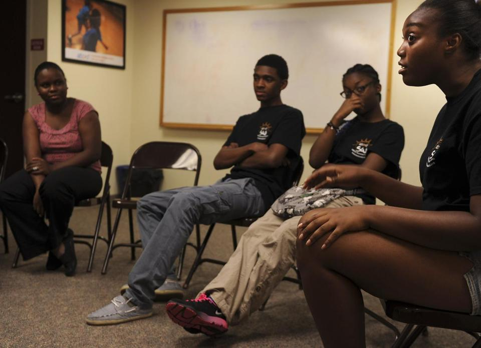 Christ-Roberte Julmice (left) Bruce Maiben, Sinain Joseph, and Daysra Robinson were among the teens in a group at ABCD Center in Dorchester who offered their views following Geroge Zimmerman's trial in the death of Trayvon Martin.