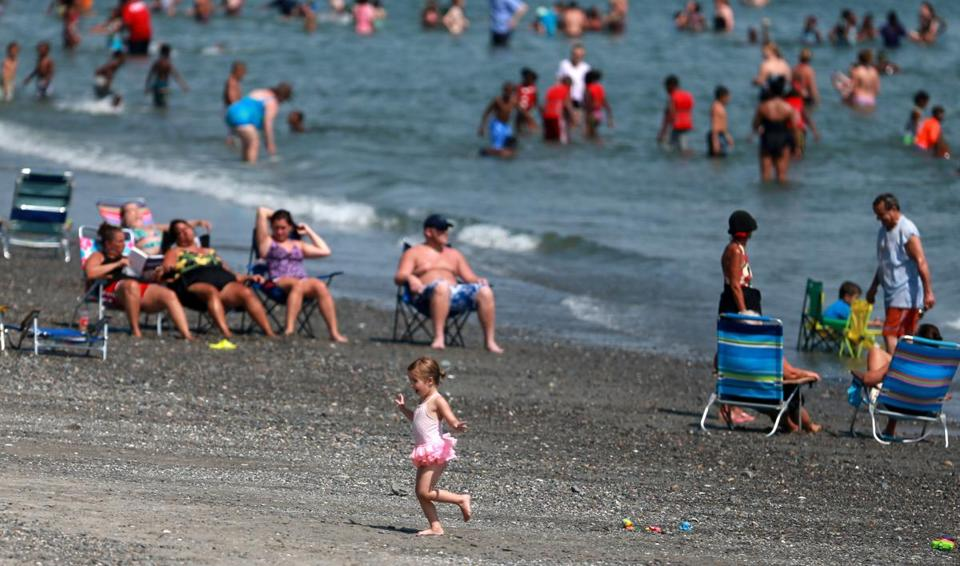 People flocked to Nantasket Beach in Hull to cool off from the heat.