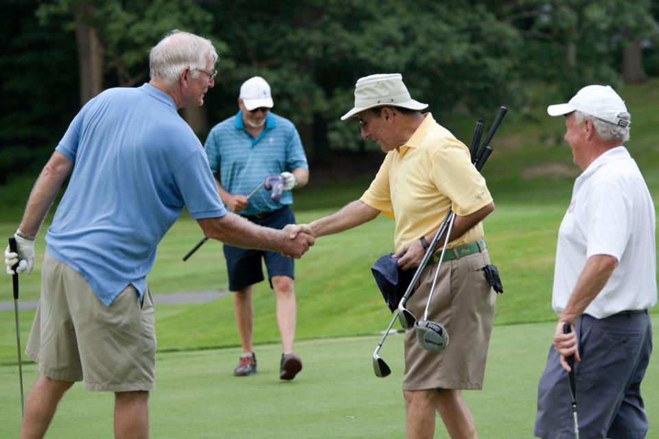 Lou Rodier and Dennis Kirshy shake hands after a recent Boston Summer Twilight League match at Charles River Country Club in Newton. The league has been around since 1921.
