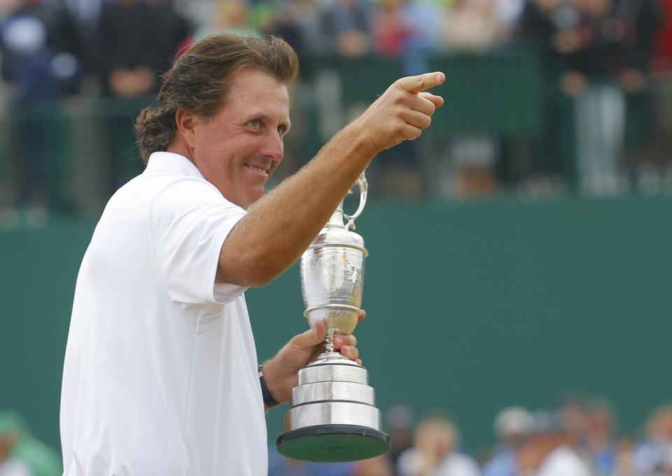 Phil Mickelson gestured as he held the Claret Jug after winning his first British Open.