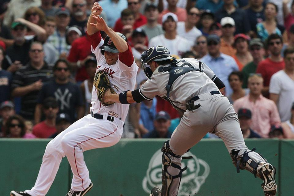 Daniel Nava got the Sox' tough day on the base paths started in the first when he was tagged out by Yankees catcher Chris Stewart (above).