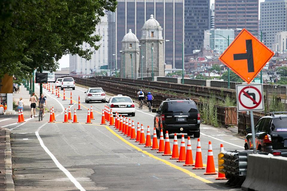 The partial closing of the Longfellow Bridge began Sunday, with traffic into Cambridge barred and Boston-bound vehicles shifted to the opposite lane. Work will take more than three years.