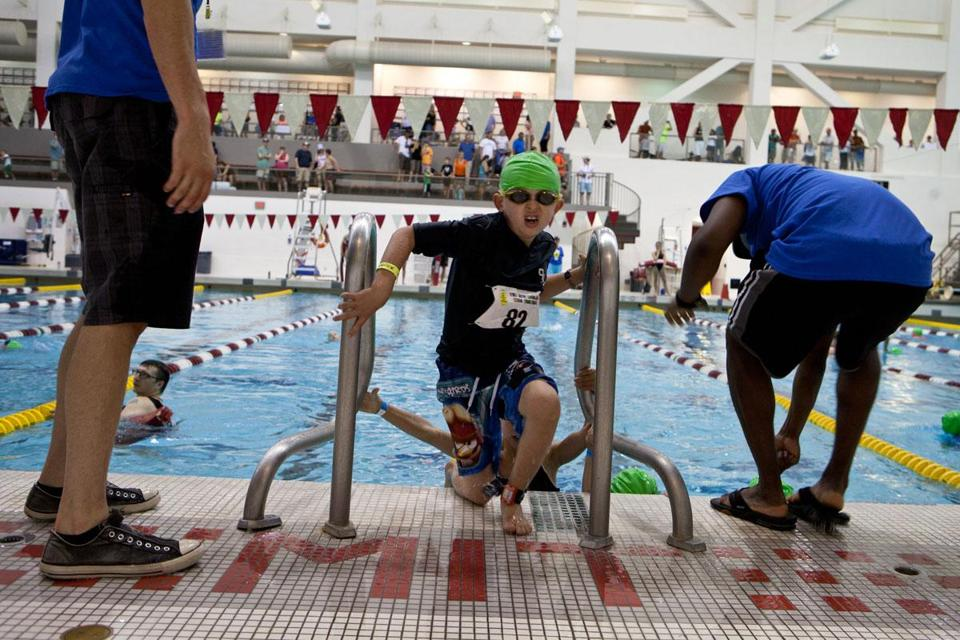 Michael Kelleher, 8, of Taunton exited the pool at MIT after a 100-yard swim.
