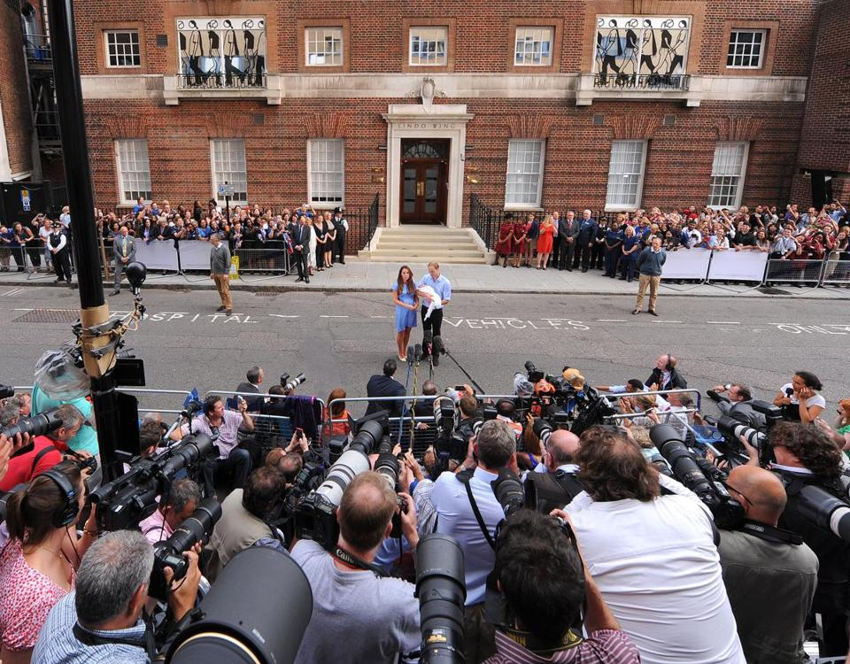 Throngs of photographers greeted the Duke and Duchess of Cambridge with their new baby in London Tuesday.