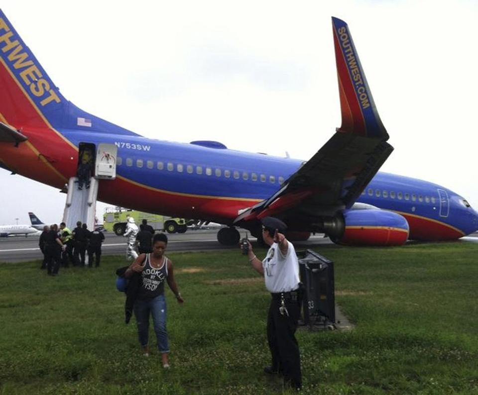 Passengers exited a Boeing 737 after its landing gear malfunctioned at La Guardia Airport in New York.