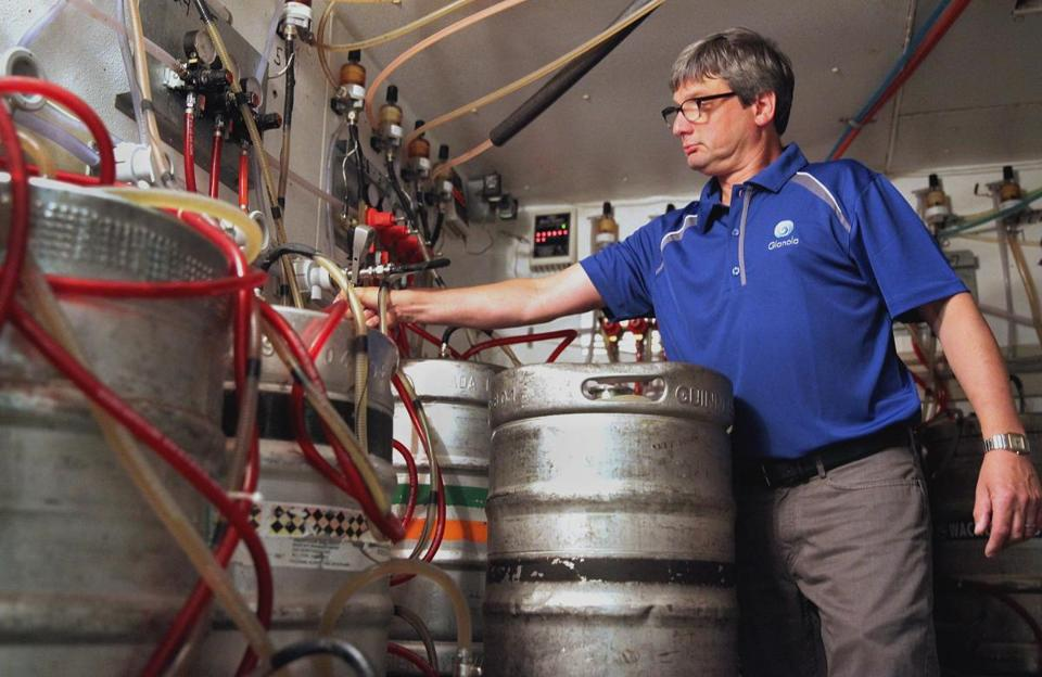Co-owner David Buckley attached a keg line to a cleaning connector at the Port Tavern in Newburyport.
