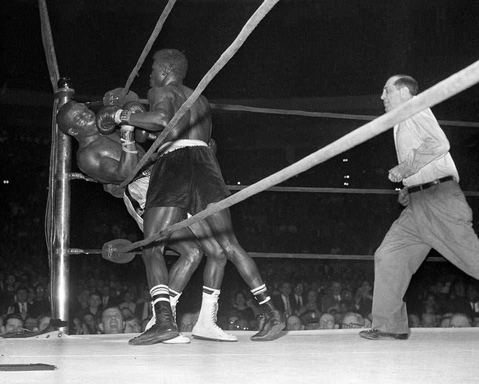 Referee Ruby Goldstein rushed to pull Emile Griffith off Benny Paret in the 12th round of their fight.