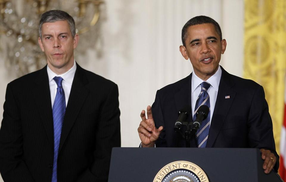 Education Secretary Arne Duncan (left, with President Obama) advocated for lower student loan rates in 2014.