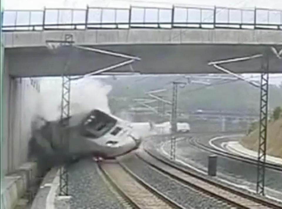 Images like this one from security camera video show a passenger train derailing in Santiago de Compostela, Spain, on Wednesday. Spanish news reports said the train was going more than double the speed limit.