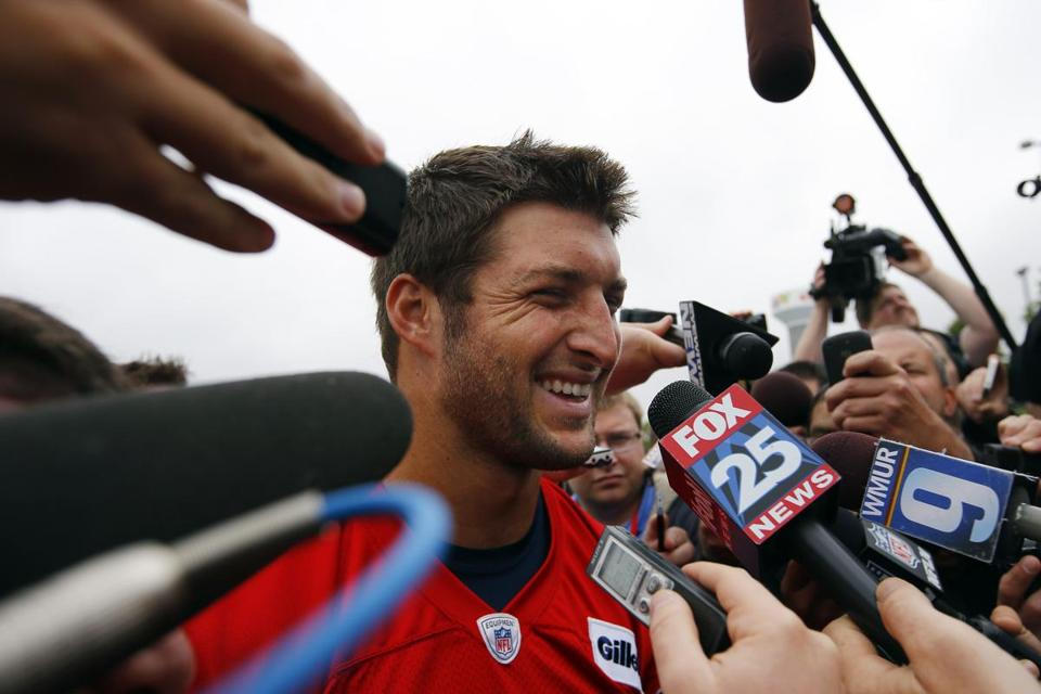 Tim Tebow met a crush of reporters when he first appeared with the Patriots at minicamp in June.