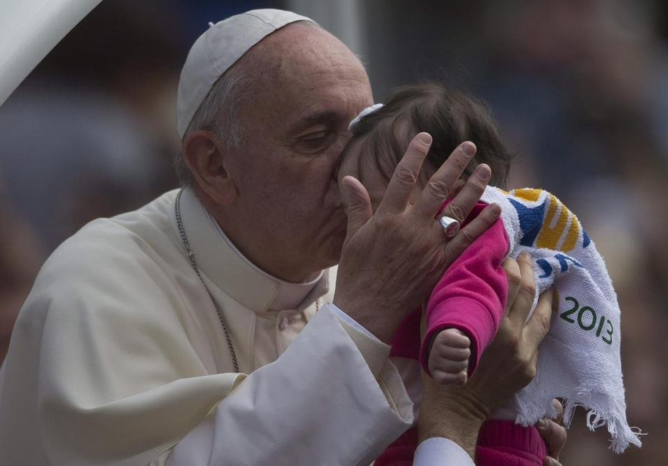 Pope Francis kissed a child in San Joaquin square in Rio de Janeiro, where he visited for this week's World Youth Day.