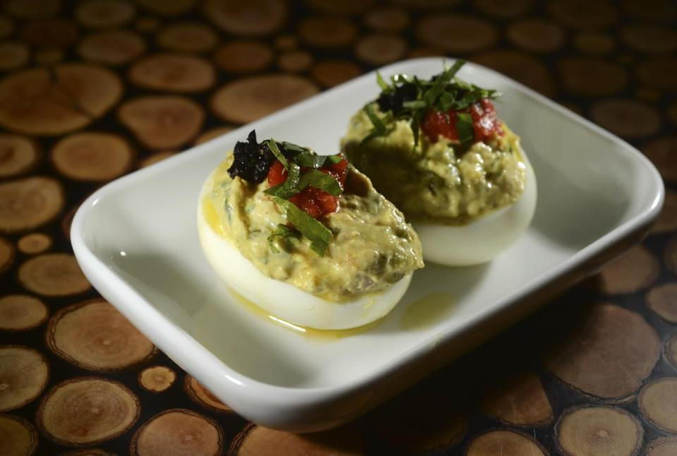 Deviled eggs with tuna and black olives added to the creamy yolk at Oleana.