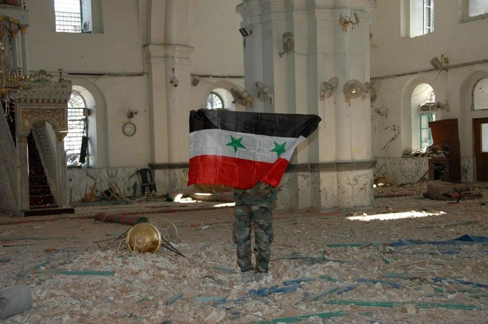 Syrian regime troops captured the Khalid Ibn al-Walid Mosque in Homs on Saturday, expelling rebels who had held the 13th-century landmark for more than a year.