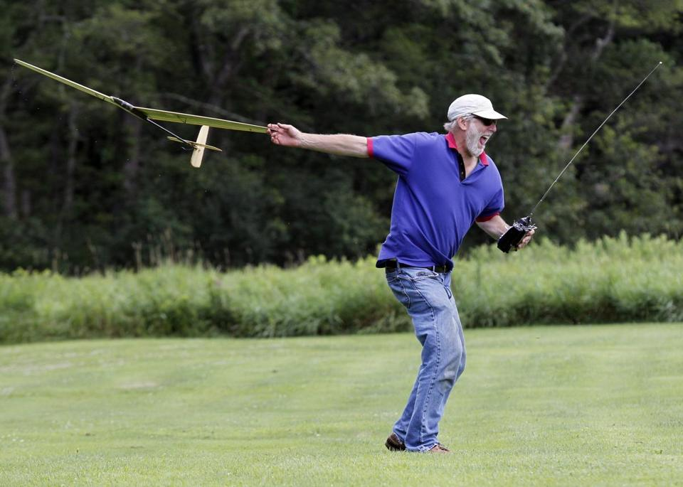 Jonathan Pozner of Canton winds up to fling a discus-launch glider into the air at the Lazy Loopers Flying Club gathering in Wrentham.