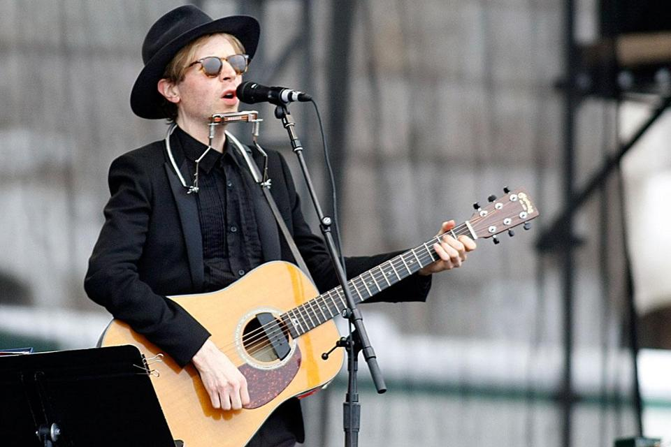 Indie rocker Beck had the crowd on their feet and dancing in his festival-closing set on Sunday.