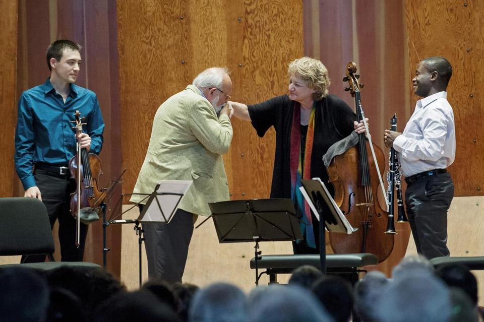 Composer Krzysztof Penderecki kisses the hand of  Marcy Rosen on Sunday, with Daniel Kim (left) and Anthony McGill.