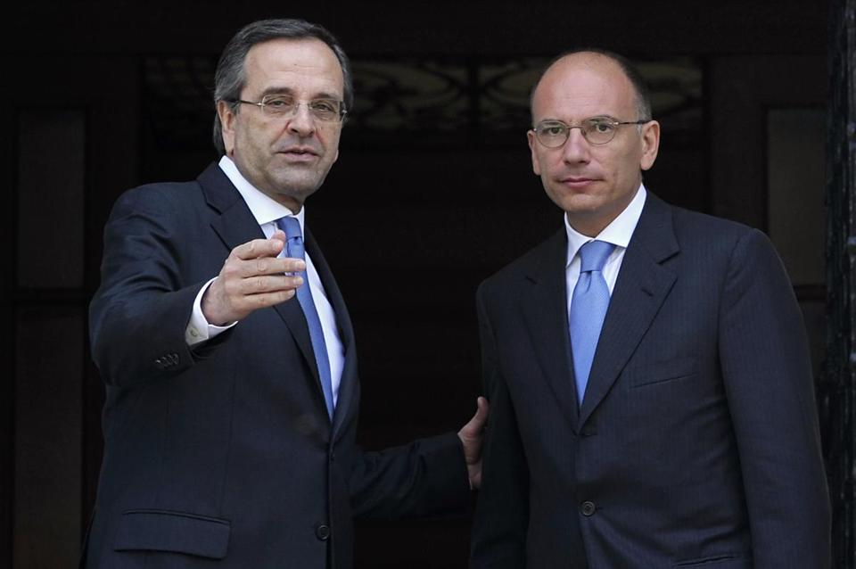 The prime minister of Greece, Antonis Samaras (left), with Italian Premier Enrico Letta, said Monday that austerity policies are hurting his country's efforts to reduce debt.