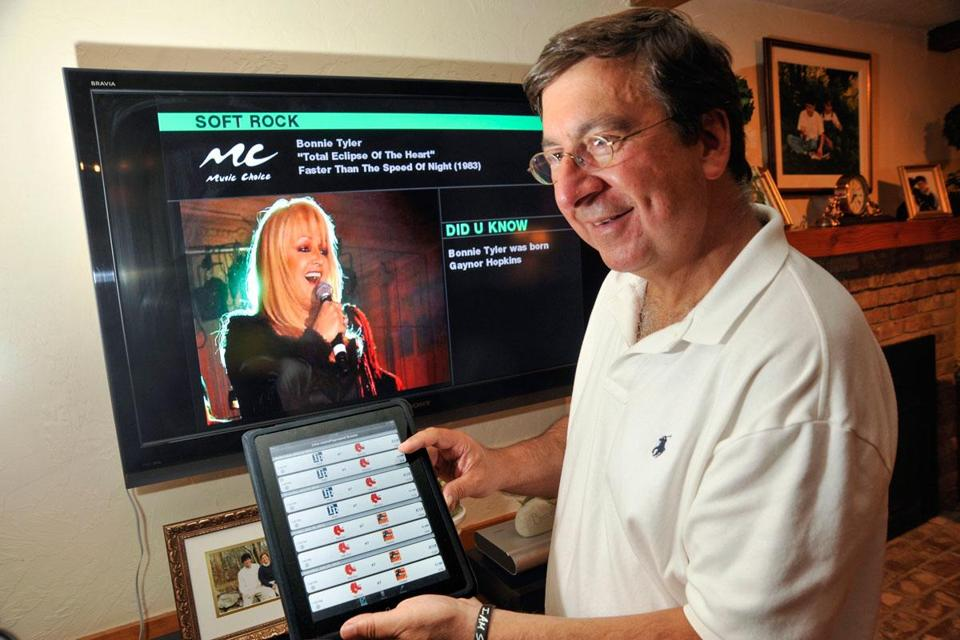 Rich Theriault's tablet had TV listings used in switching from a Red Sox game to a rock station in a game's commercial break. A MyChoice device can automatically do the switch.