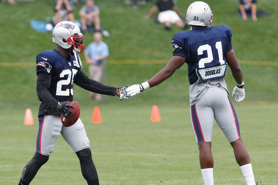 Patriots cornerback Kyle Arrington (left) slapped hands with teammate Ras-I Dowling during practice.