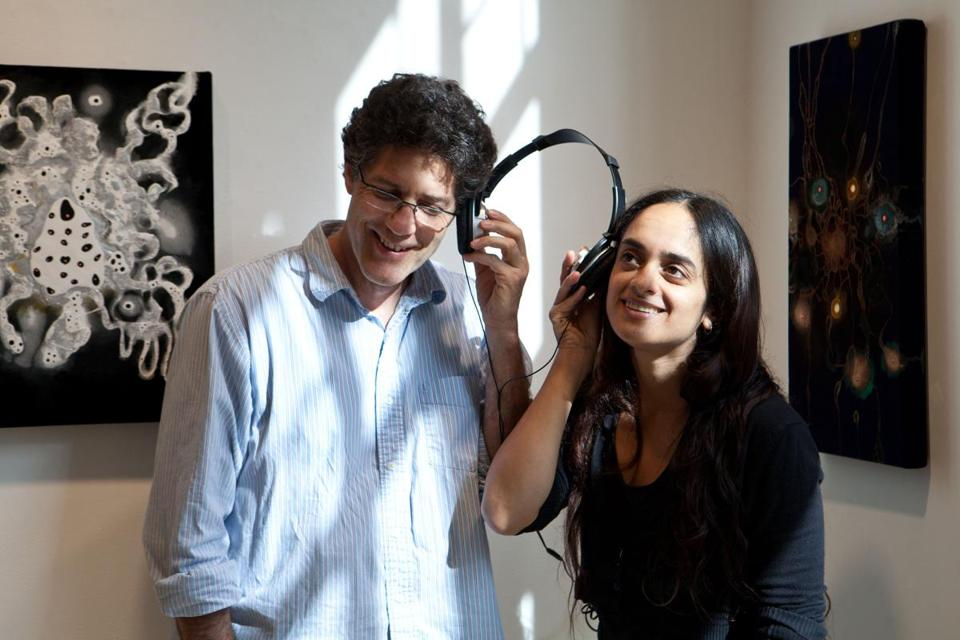 "Steven Bogart and Mali Sastri at the Bromfield Gallery, where their exhibit of art and music, ""Ten Paintings/Ten Songs,"" is showing."