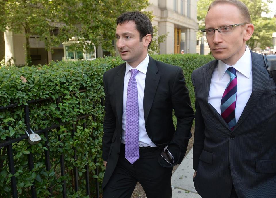 Former Goldman Sachs trader Fabrice Tourre (left), shown leaving federal court in New York Tuesday, knew that a portfolio backed by subprime mortgages was designed to fail, the government argues — and pay him a bonus if it did.