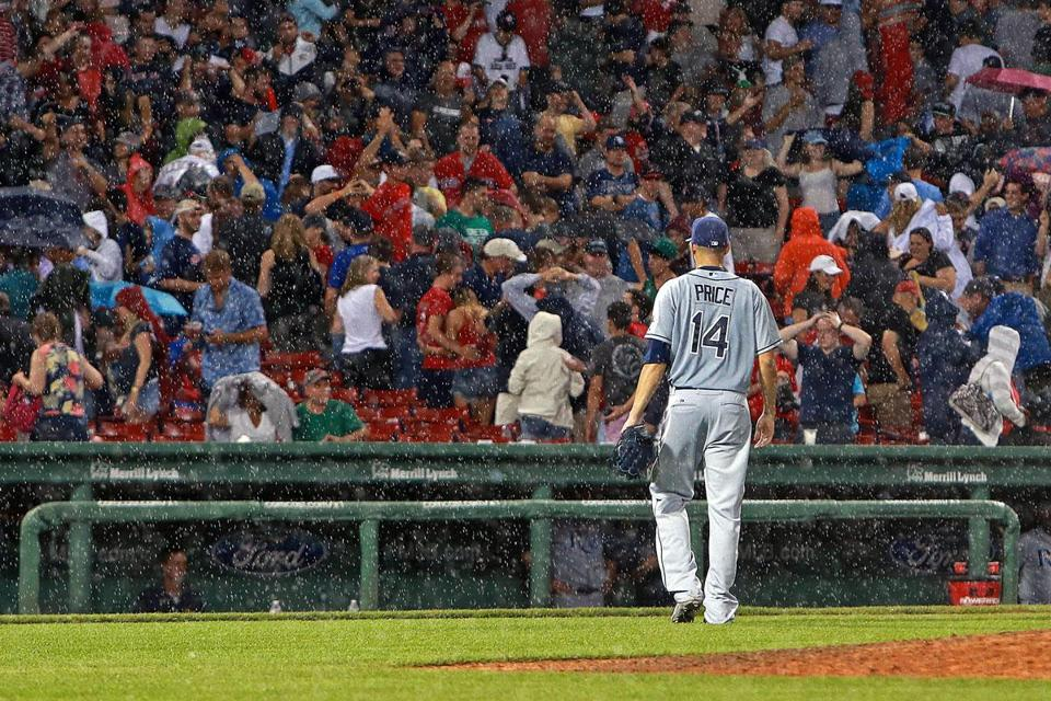 David Price heads to the dugout during a rain delay in the eighth inning. The Rays ace came back for one more batter.