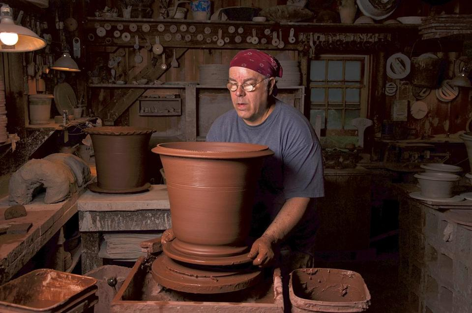 Master potter Guy Wolff at work in his studio in Bantam, Conn.