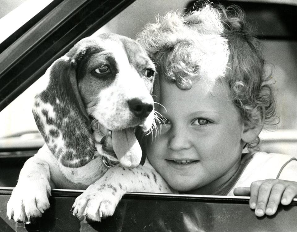 "Four-year old Darlene Butte of Merrimack, NH with four-month old ""Freckles"" the dog."