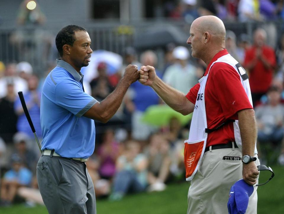 Tiger Woods celebrated with his caddy, Joe LaCava, after finishing his round on Friday.