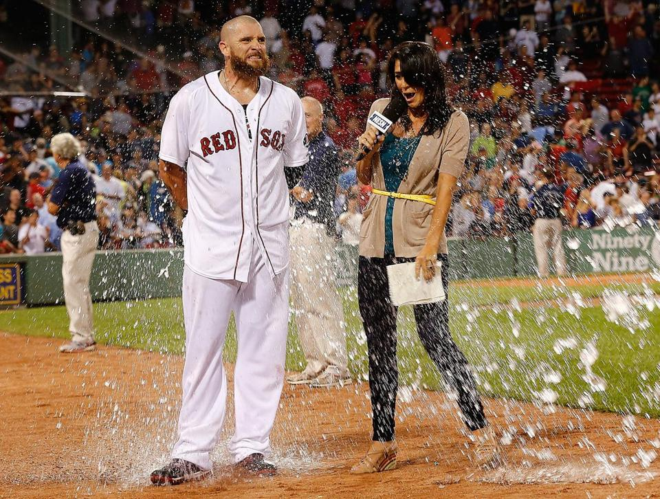Jonny Gomes was doused by a teammate after the Red Sox win.