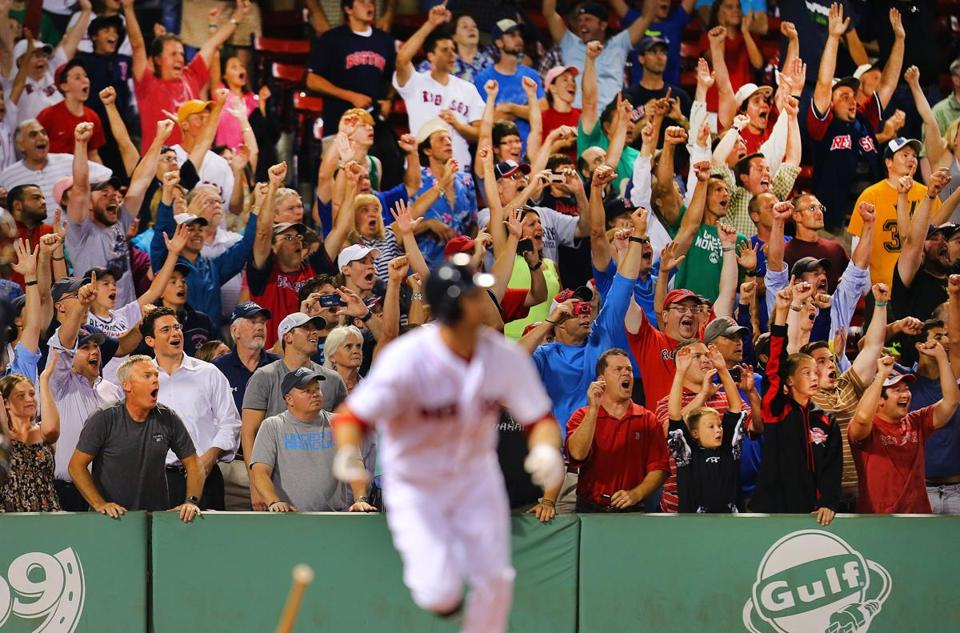 Fans at Fenway Park celebrated when Daniel Nava blasted the game-winning hit to center field.