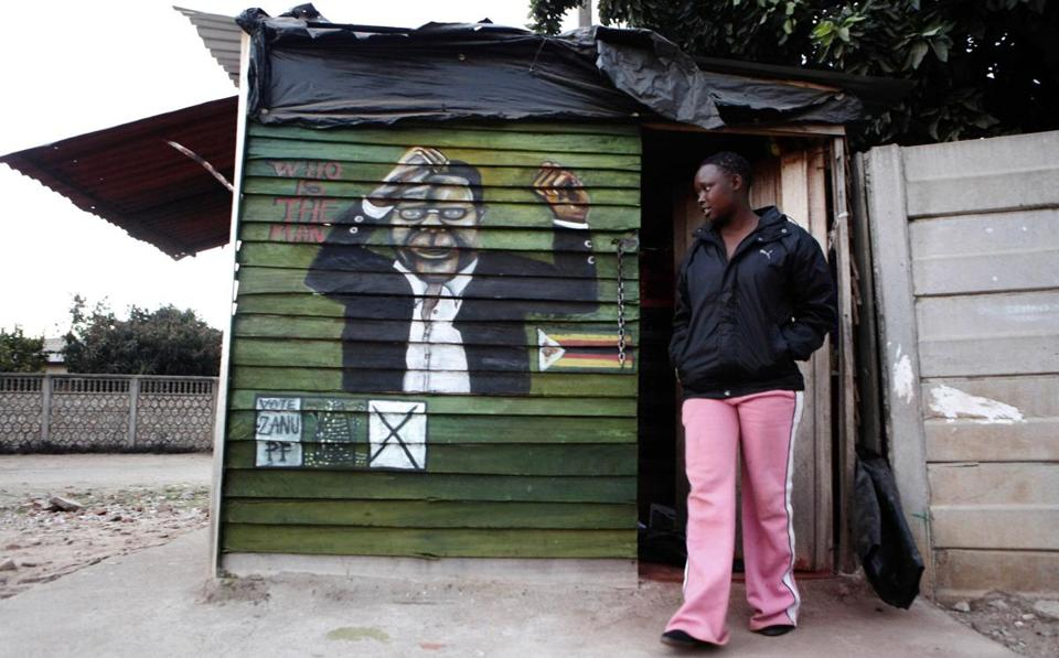 A teenager walked past a depiction of Robert Mugabe on Friday in a suburb of Harare, the nation's capital.