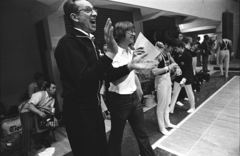 Penn State gymnastics coach Gene Wettstone (left) applauded his team's efforts during the NCAA gymnastics championships in Philadelphia in April 1976.