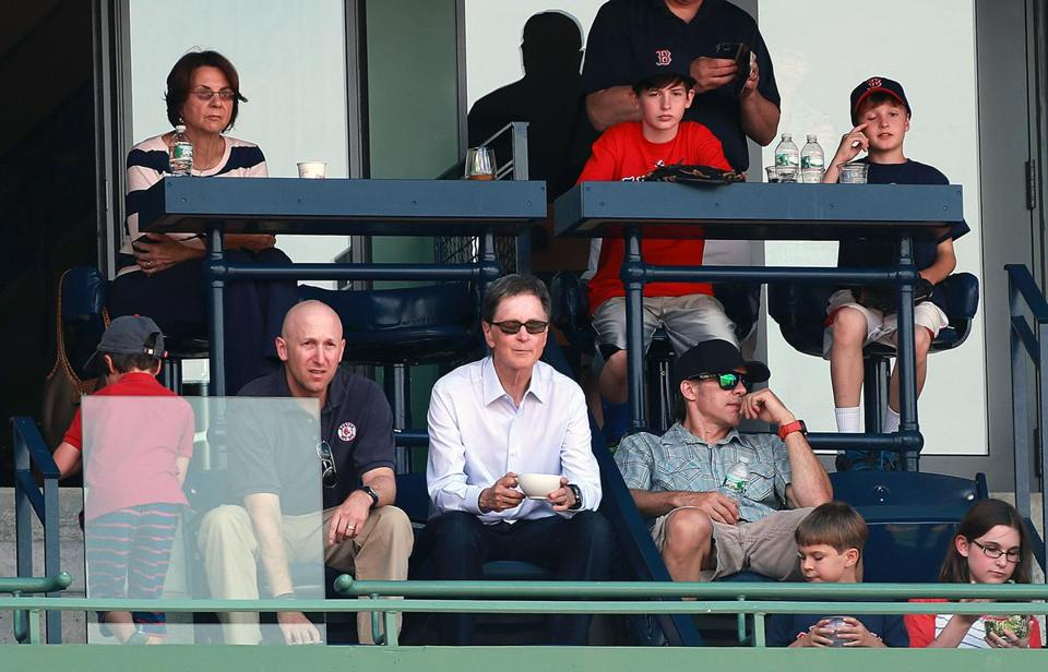 John Henry, center, whose bid for the Globe was accepted by the Times Co., spent Sunday evening watching the Boston Red Sox play Arizona from the EMC Level at Fenway Park.