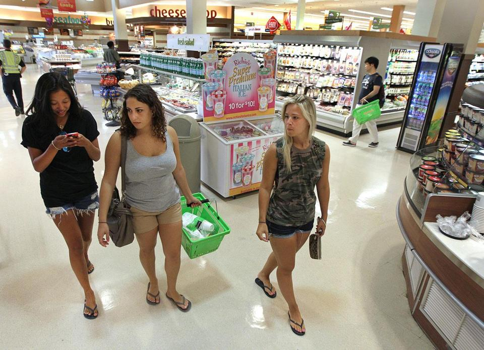 Anna Volain (center), 20, shopping for snacks at Shaw's on Commonwealth Avenue with friends Liza Posner (left), 20, and Isabel Monteiro, 21.