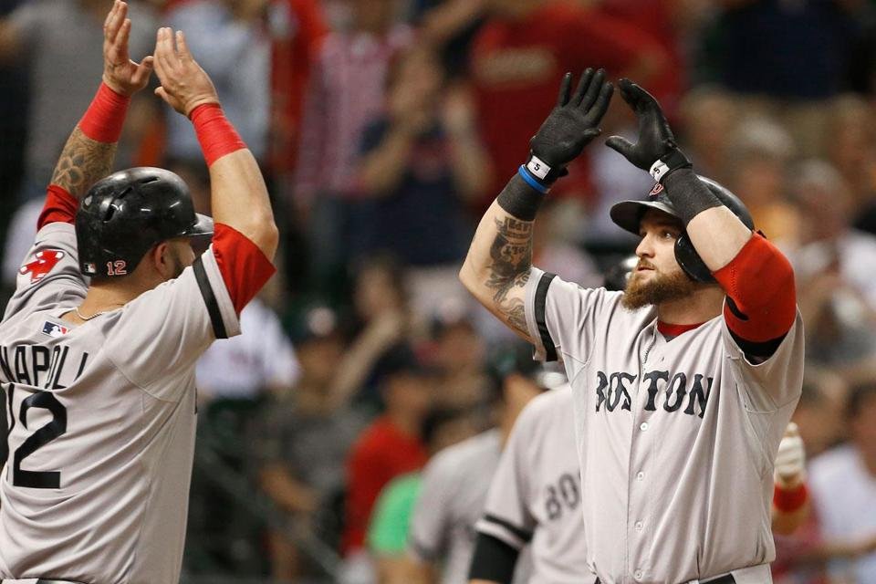 Mike Napoli welcomes Jonny Gomes after Gomes's three-run home run in the sixth.